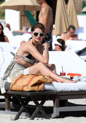 http://img176.imagevenue.com/loc393/th_311827556_Mischa_Barton_Bikini_Candids_on_the_Beach_in_Miami_December_27_2011_110_122_393lo.jpg