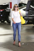 Reese Witherspoon in jeans out in Brentwood 02/25/14