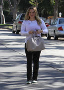 http://img176.imagevenue.com/loc534/th_312192653_Hilary_Duff_Out_to_vote17_122_534lo.jpg