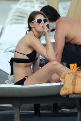 http://img176.imagevenue.com/loc587/th_311878928_Mischa_Barton_Bikini_Candids_on_the_Beach_in_Miami_December_27_2011_126_122_587lo.jpg